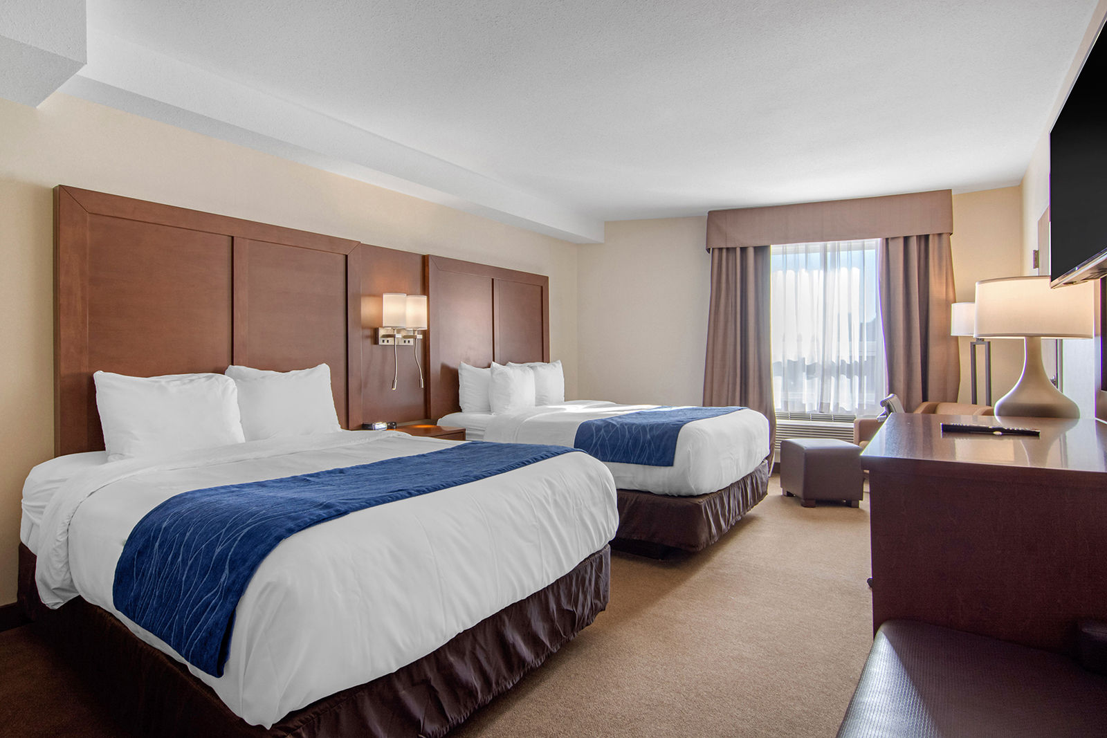 Rooms have been outfitted with modern and bright furnishings, including new beds and bedding, as well as amenities such as 50-inch TVs.